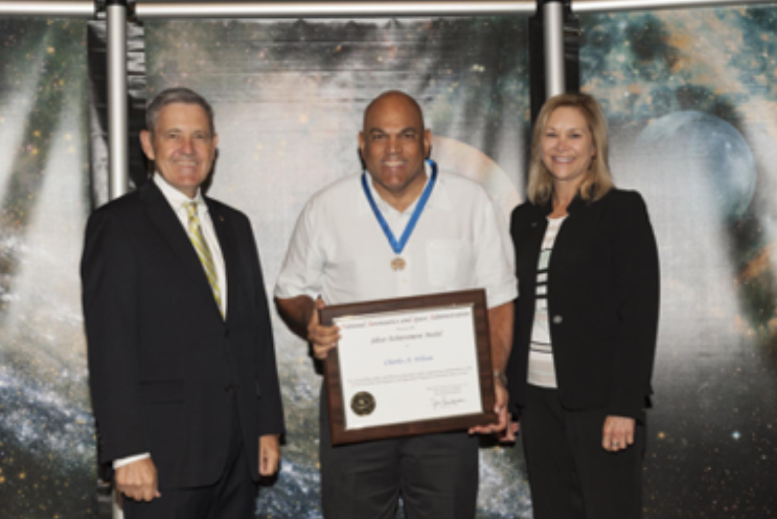 Pictured from left to right: KSC Center Director - Bob Cabana, Charles Wilson, KSC Deputy Diretor - Janet Petro